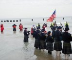 Bagpipers from the Shannon Rovers Irish Pipe Band play songs for the first round of plungers. (Katie Watkins/MEDILL)