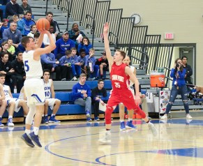 Conner Tomasic (LC)attempts a 3-point shot with freshman Ty Smith (CP) contesting. Lake Central hit four 3-point shots during the course of the game, while Crown Point was only able to hit one 3-pointer. (Erik Alcantar/MEDILL)