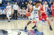 Keon Sellers (LC)dribbles against sophomore Sam Decker (CP). Lake Central Head Coach Dave Milausnic used nine players in the first quarter, making good use of his bench and showing the Bulldogs multiple looks early on in the game. (Erik Alcantar/MEDILL)