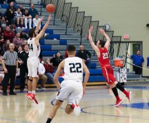 Noah Durr attempts a 3-point shot that would have tied the game late in the 4th quarter. It fell short of the basket and was rebounded by Munster, and was ultimately what sealed the victory for the Mustangs. (Erik Alcantar/MEDILL)