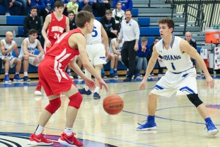 Junior Matt Hanlon (CP) looks for space to make pass while guarded by sophomore Derek Hobbs (LC). After Lake Central (St. John) and Crown Point (Crown Point) combined to score 115 in their first matchup, both teams worked much harder on their defenses. (Erik Alcantar/MEDILL)