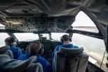Pilot Lt. Rob Mitchell, flight engineer Paul Darby and Flight Commander Justin Kibbey navigate the P-3 into the air. (Morgan Levey/Medill)
