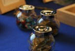 "Jars of various herbs — pictured here are sage, cedar and ""gifts,"" or tobacco ties — provided attendees examples of the medicinal herbs that they could touch and smell. (Katie Rice/Medill)"