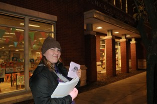 Virginia Iungerich, 25, a member of the Chicago Northside Democratic Socialists of America, prepares her quarter-sheet flyers outside a polling place, the Rogers Park branch of the Chicago Public Library. (Becky Dernbach / MEDILL)