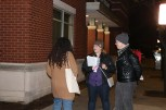 Anwuli Anigbo, 30, approaches DSA volunteers Virginia Iungerich and Colin Hill. Anigbo is volunteering with Maria Hadden's City Council campaign to unseat incumbent 49th Ward Ald. Joe Moore. She was collecting signatures to qualify Hadden for the February ballot. (Becky Dernbach /MEDILL)