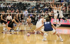 Loyola's Collin Mahan (back right) tucks a shot around the block and past Penn State libero Will Bantle for one of his career-high 24 kills. Mahan added in 11 digs for his sixth career double-double. (Tim Hackett//Medill)