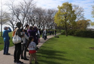 """About 35 Northwestern students, faculty and community members participated in the bird walk Monday, many with binoculars in hand. Honn opened the walk by acknowledging the area's historical and continuing significance as a homeland for indigenous people and ecologies. More than 100,000 members of varied tribes still reside in Illinois and Chicago provides a meeting space for collective healing among tribes. """"For me as a settler, it's important that I continue to acknowledge both these histories and presences and my role, and the university's role, in these colonial legacies of oppression and shaping spaces certain ways,"""" Honn said."""