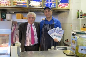 Leader of the Council Councillor Stephen Alambritis with Mr Sabit Ucar, owner of Fresh Fish Bar in South Wimbledon who will save on his business rate bill