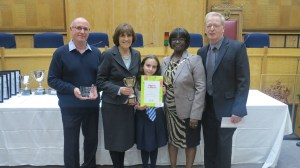 Mayor of Merton Councillor Agatha Akyigyina presents Wimbledon Chase Primary School with the award for Winner of the Best School Wildlife Garden category