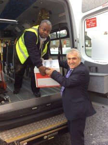 The Leader helping to transport the food donation boxes to the food bank.