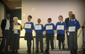 Mark Richardson with pupils from St Thomas collecting their awards.