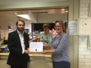 Cabinet Member for Adult Social Care and Health, Councillor Tobin Byers presents the Director of Commonside Trust, Naomi Martin with a certificate