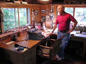 Chuck Wick with Sigurd Olson's typewriter, in Olson's Ely, Minnesota, Home.  MPR photo