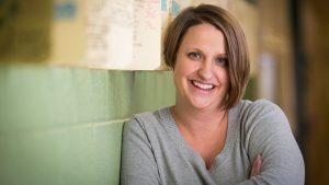 A headshot of Reesha Adamson.