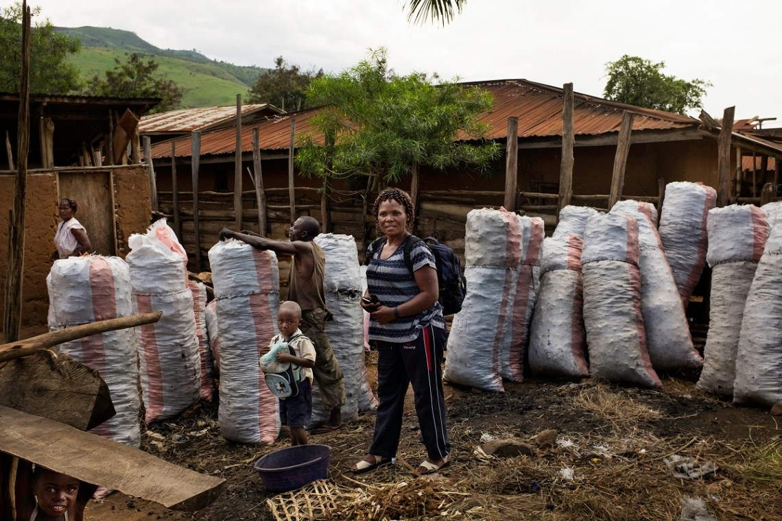 Charcoal wholesaler Marie-Médiatrice Shamba at her charcoal deposit in Goma, Nyamilima, North Kivu, DRC, November 2016. Photo by Leonora Baumann for Mongabay.