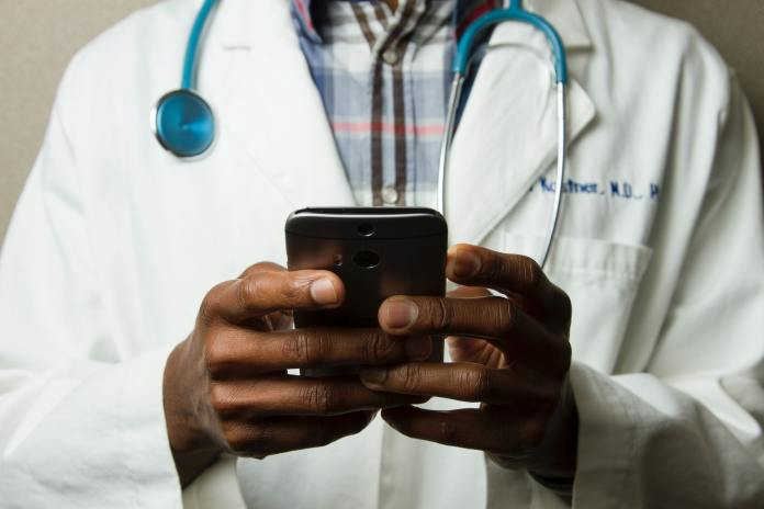 doctor checking a mobile phone