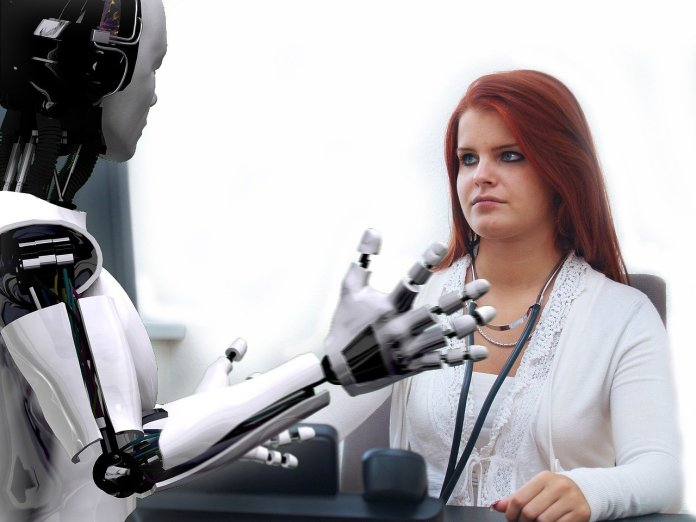 woman and a robot looking at each other