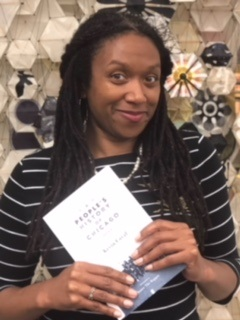 """Juanita Harrell holding the book """"A People's History of Chicago"""""""