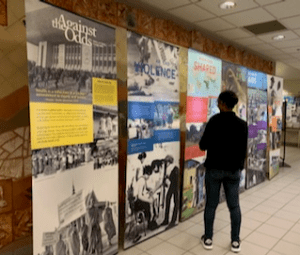 man standing in front of a row of exhibit banners
