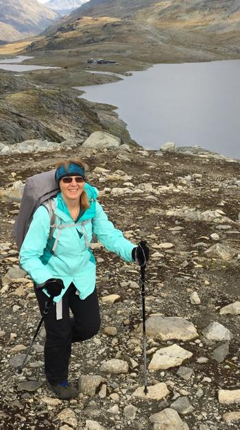 woman hiking on a rocky terrain.