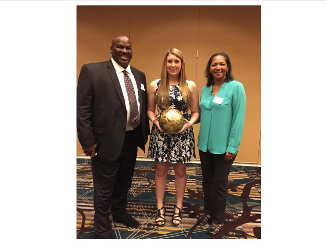 SCC Athletics Director Steve Eskridge (left) and Raquel Chumpitaz-West, Women's Commissioner, Head Volleyball Coach (right) stand with Hayley Warren who was named the Baden NWAC Athlete of the Year for Women's Soccer as well as recognized with the North Region MVP award.