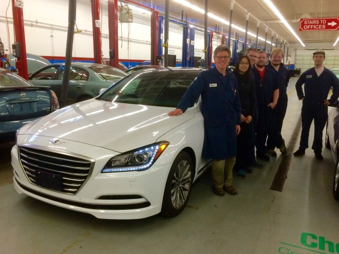 Shoreline students pose with a 2015 Hyundai Genesis donated to the college's automotive program by Hyundai Motor America.