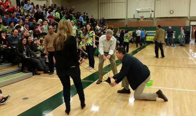 Shoreline Mayor Chris Roberts (lower right), with the assistance of Shoreline School District Board Member David Wilson (upper) and catapults Math Oympiad t-shirts into the crowd