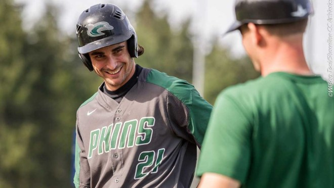 Zane Zurbrugg, Shoreline Dolphin outfielder, smiles at a teammate.