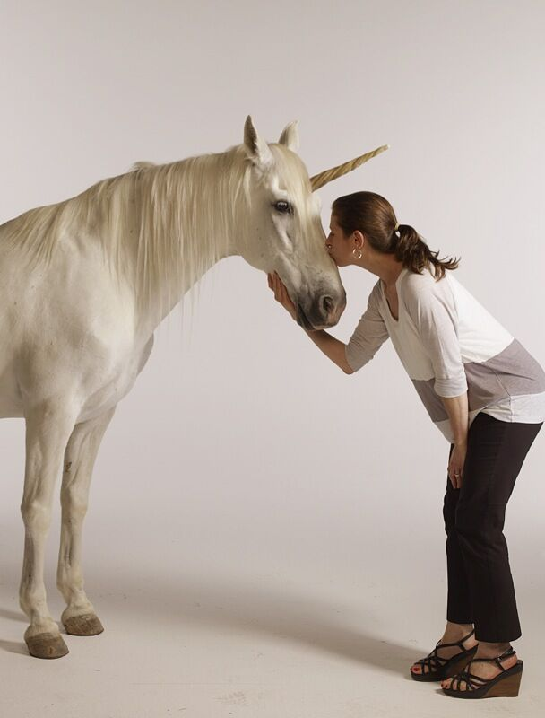 Karen Frank kisses a unicorn