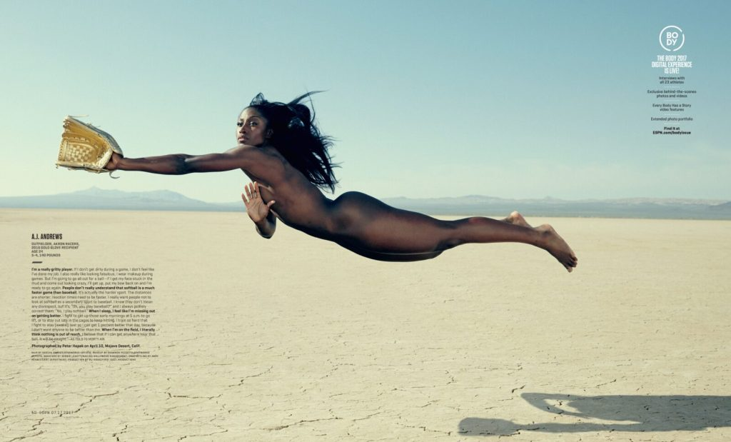 AJ Andrews dives in midair across a desert background with her golden glove in hand