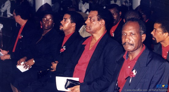 Mourners at Kenneth John's burial  ceremony held at the Good Shepherd Parish in Babonneau . There were red shirts inside and outside.