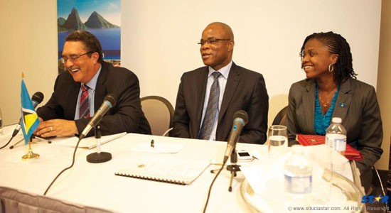 From left: Prime Minister Kenny Anthony, Consul General to Canada, Michael Willius and Press secretary Jadia Jn Pierre-Emmanuel at a town hall meeting in Canada. The prime minister skirted over the issue of the government paying the medical bills of his press secretary.