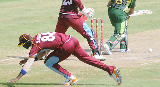 Blame it on the rain! Darren Sammy lost his footing on a slippery surface.