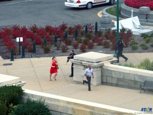 "People run for cover as police converge to the site of a shooting Oct. 3 on Capitol Hill in Washington. The U.S. Capitol was placed on security lockdown Thursday after shots were fired outside the complex, senators said. ""Shots fired outside the Capitol. We are in temporary lock down,"" Senator Claire McCaskill said on Twitter. (Photo: Mandel Ngan, AFP/Getty Images)"