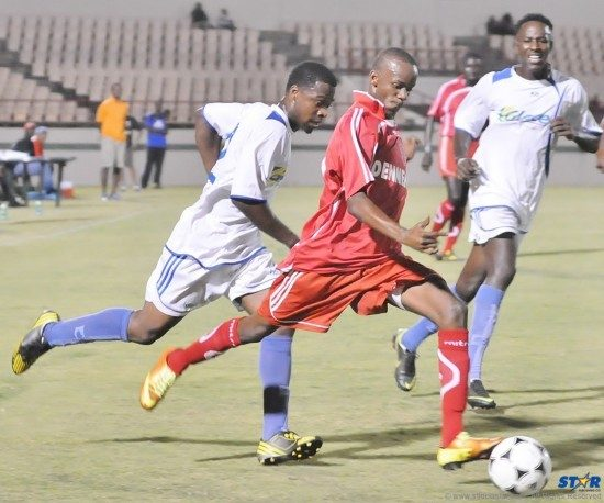Action from Sunday's Super League final between Gros Islet (white uniform) and Dennery.