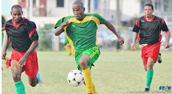 VSADC players in pursuit of a Prophets and Kings forward during Sunday's game at the Gros Islet Playing Field.