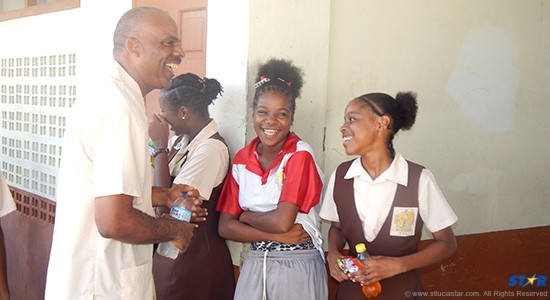 Past and present pupils shooting the breeze about the joys of Choiseul Secondary.