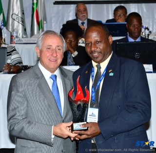 Brian Louisy (r) accepts an award for outstanding  performance in event organization at a ceremony  in Mexico.
