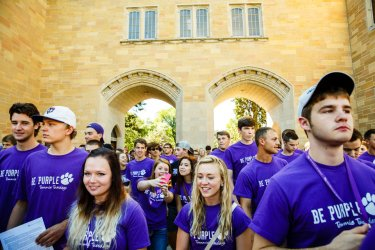 Students processed under The Arches and across the lower quad. (Photo by Mark Brown)