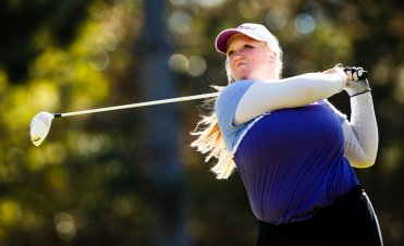 Erin Dingmann tees off during the women's golf MIAC Championship in Coon Rapids. (Photo by Mike Ekern '02)