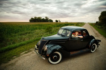 Student Chloé Knutson sits in her 1937 Ford Coupe, named Ophelia. Chloé and her father, Wayne Knutson, worked together to restore the car. Look for more coverage of Chloé in the Winter 2015 issue of St. Thomas magazine.