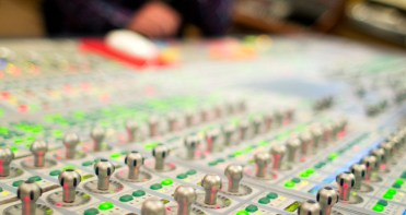 A mixing board is seen during a music business class at Essential Sessions music studio in St. Paul.