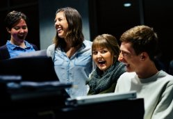From left; Quinlan Keller, Madeline Schuster, Hannah Tilstra and Aaron VanDanacker laugh during a practice session.