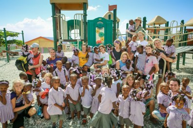 St. Thomas students enjoy playing with some of the 350 children who attend Grace Academy in Titanyen. Half of grade-school-age children do not attend school because their parents cannot afford it.