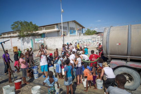 St. Thomas students work with Healing Haiti, which delivers fresh water to Cite Soleil, a slum on the edge of Port-au-Prince.