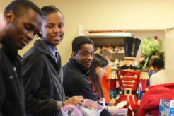 (L-R) Raymond Nkwain Kindva, Tiana Daniels, James Mite and Quinmill Lei do community service at the Ronald McDonald House, Birmingham, Alabama. Photo by Kathryn Hubly.