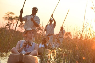 """Second Place, Tommies Abroad: Evan Keil, Botswana, Africa. """"Mokoro ride through the reeds: We were blessed with the opportunity to take a class in the heart of Botswana, Africa. We spent many days seeing firsthand the difficulties that Botswana has gone through and is currently facing. We ended our trip with a safari in the delta region of the country and had the opportunity to be guided through the shallow marsh area in the traditional fashion. These 'Mokoro' canoes are carved from a tree and used to travel across far distances – in this case, to the hippo pool."""""""