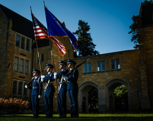The Air Force ROTC color guard poses by The Arches.