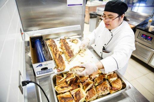 Ericka Boice prepares Cubano sandwiches.
