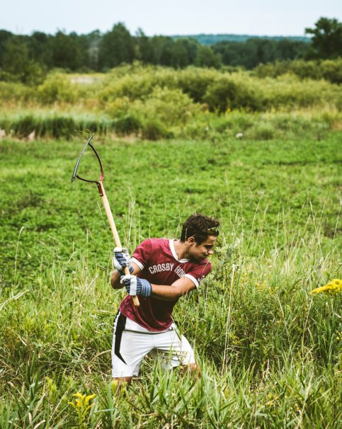Will Goodwin clears weeds.